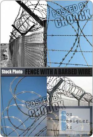 Stock Photo: Fence with a barbed wire